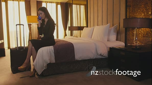 Asian Woman Speaking On Telephone In Hotel Room 5186