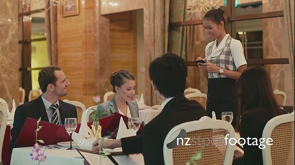 Group Of Men And Women Eating In Luxury Restaurant. 5192
