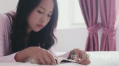 Asian Female Teens Using Digital Tablet And Reading Book On Bed  5203
