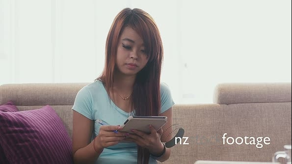 Young Asian Woman Using Ipad For College Homework 5209