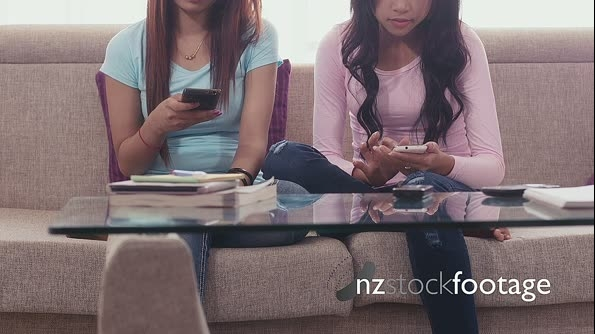 Young Asian Women Using Mobile Phone For Internet, Email At Home 5211