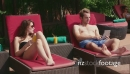Portrait Of Husband and Wife Relaxing In Resort Swimming Pool 5245