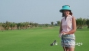 Asian Woman Smiling At Camera On Golf Course 5254