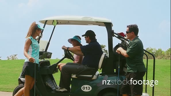 Group Of Friends Talking And Laughing On Golf Cart 5255