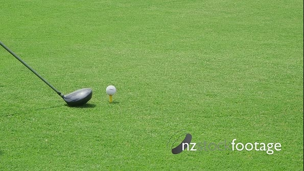 Closeup Of Golf Bat Hitting Ball On Grass 5256