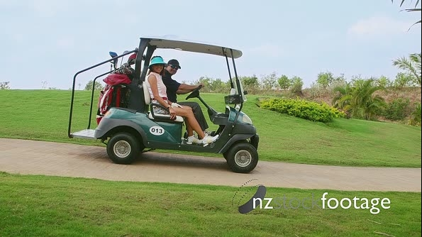 Happy Husband And Wife On Golf Course 5258