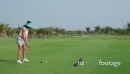 Woman Hitting Ball In Golf Club 5272