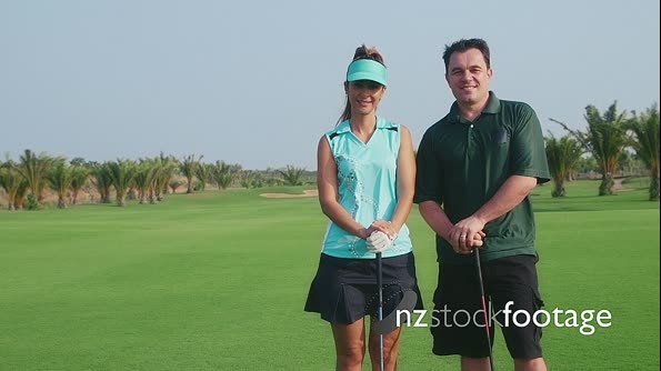 Portrait of Interracial Couple Smiling At Camera On Golf Course 5298