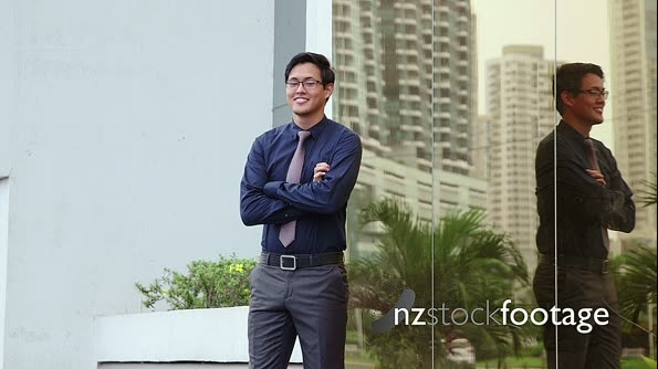 Portrait of proud, confident asian businessman smiling 5756
