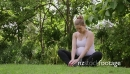 Relaxed pregnant woman, mom doing yoga in park, motherhood 5766