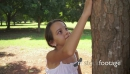 Happy school girl hugging tree in park, ecology, people 5783