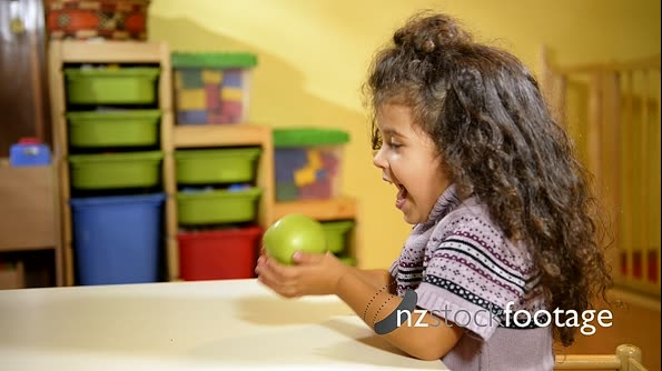 Little Girl Eating Green Apple And Fruit In Kindergarten 6158
