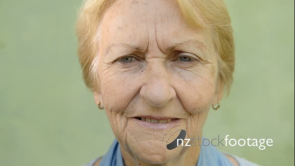 Portrait Of Old Woman Smiling At Camera 6165