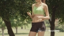 Girl With Mp3 Player Running in City Park 6169