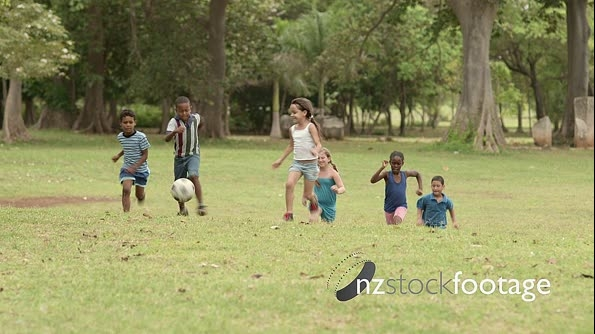 Happy Kids Running, Having Fun Playing Soccer With Football 6174
