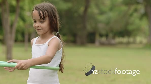 Cute Little Girl Playing With Hula Hoop And Having Fun 6184