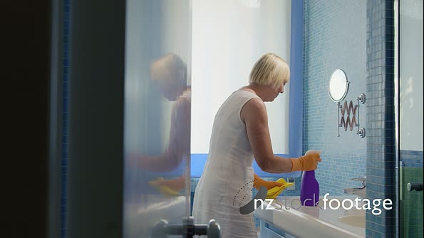Senior Woman Doing Chores In Bathroom At Home 6201