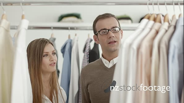 Man Talking With Sales Manager In Fashion Shop While Shopping 6290