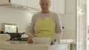 Senior Woman On The Phone And Cooking In Home Kitchen 6313
