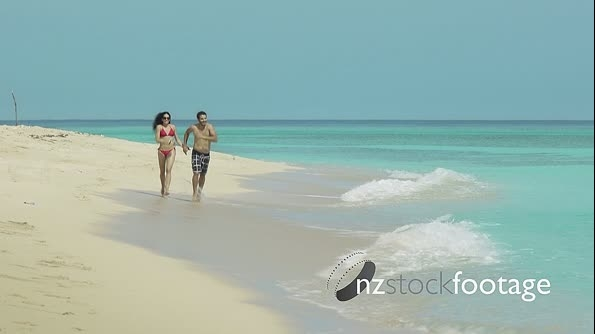 Young Man And Woman Running Near The Sea On Beach 6399