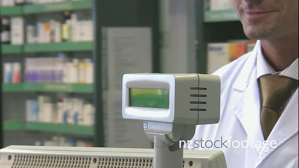 Pharmacist Taking Money From Customer In Pharmacy 7413