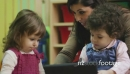 School With Teacher Showing Ipad To Children 7419