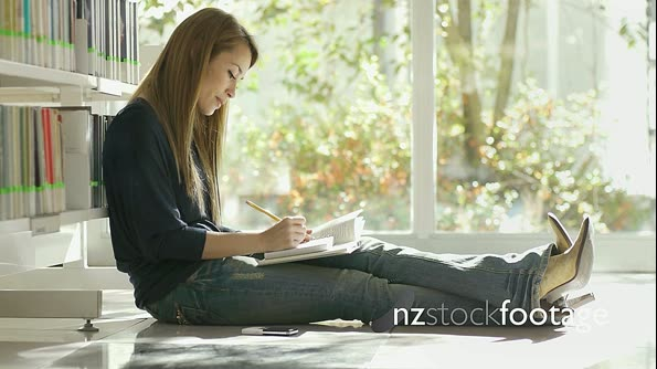 Young Woman Studying In School Library 7436