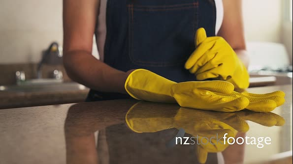 Young Hispanic Woman With Yellow Latex Gloves Cleaning Home 8037