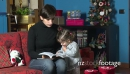 Mom Reading Book To Child During Xmas Holidays At Home 8420